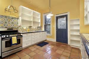 backsplash for yellow kitchen kitchen idea of the day mexican style kitchen with yellow walls ornate tile backsplash and