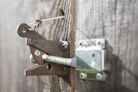 backyard gate lock metal gate latch of garden gate photograph by bryan mullennix