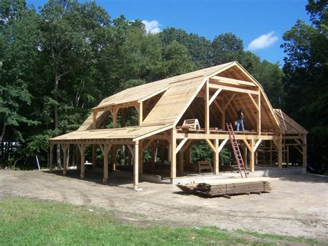 gambrel pole barn cordwood frame with gambrel roof like the structure