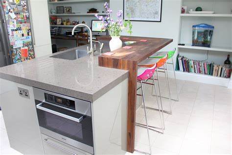 kitchen island with raised seating area island incorporating microwave oven dishwasher sink and