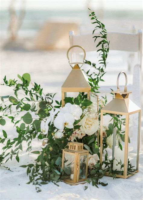 gold lantern centerpieces longboat key club wedding florals by blooms gold lanterns orchids the wedding