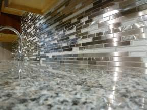 white and metal marme random mosaic backsplash