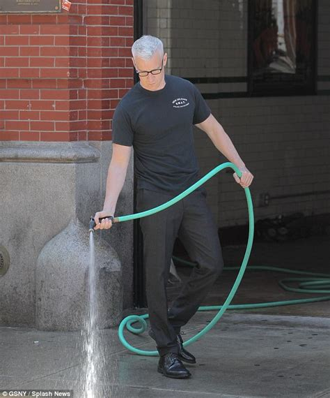 anderson cooper hoses down the sidewalk in front of his