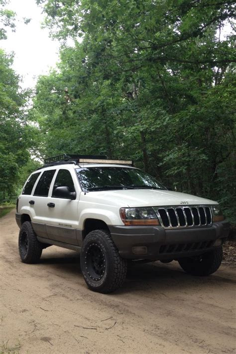 jeep grand light bar jeep grand wj lifted 2 quot light bar roof rack