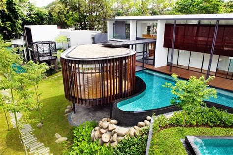 Charmant Abri De Jardin Original #5: piscine-hors-sol-moderne-forme-asym%C3%A9trique-bardage-pierre-jardin-gazon.jpg