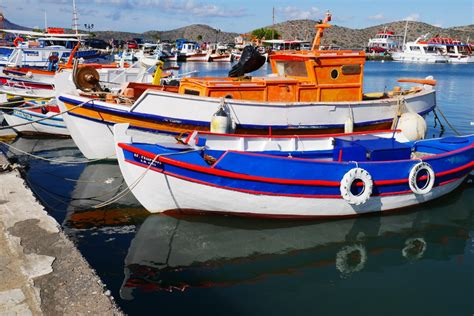 greek fishing boat images free images sea rustic reflection vehicle holiday
