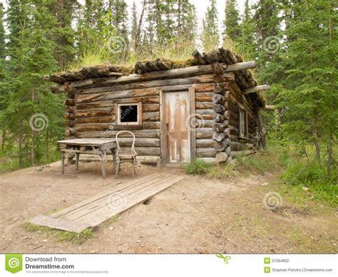 Traditional Log Cabin by Traditional Log Cabin Rotting In Yukon Taiga Stock