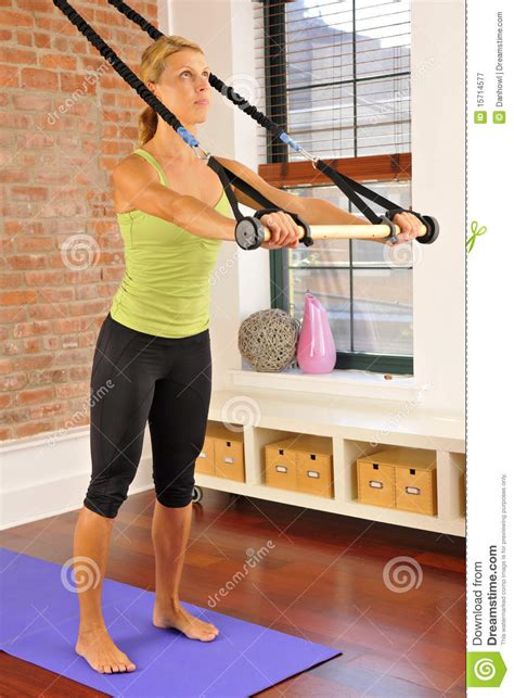 pilates exercise with bar at home royalty free stock