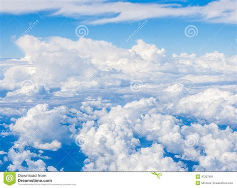 white fluffy lights blue sky and fluffy clouds light royalty free stock