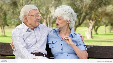 old couple on bench old couple on a bench talking stock video footage 4610761