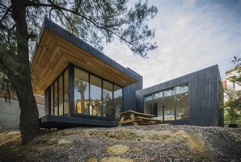 cabin architecture green roofed timber cabin floats above the ground in