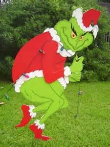 Grinch stealing christmas lights yard art
