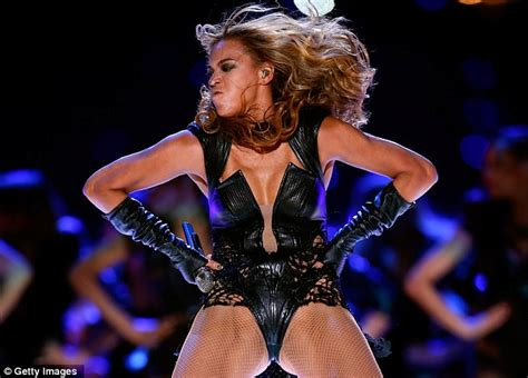 beyonce is picture in romper and fishnets as