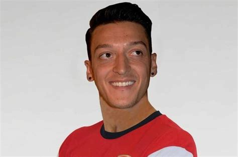 the biography of mesut ozil picture special mesut ozil pulls on arsenal shirt as