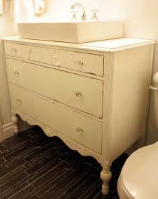 antique dresser turned vanity painting the roses white