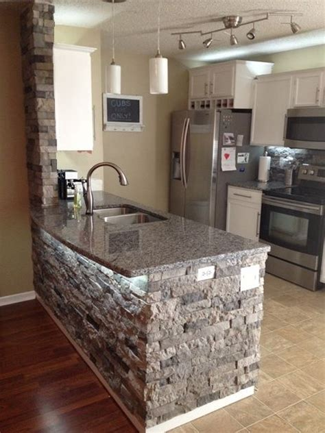 stone kitchen island airstone spring creek home pinterest stone island islands and fireplaces