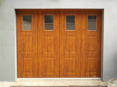 porte de garage 4 vantaux bois alu et pvc pergolas
