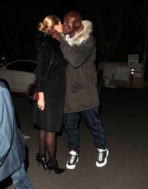 heidi klum and husband heidi klum and seal reunite for a christmas kiss as