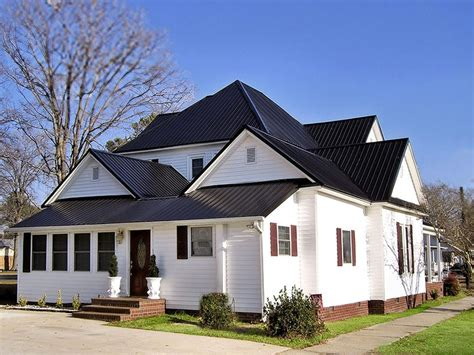 white exterior with black metal roof house colors metal roof its ok and black metal