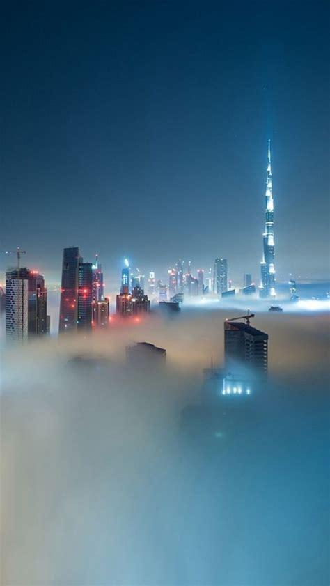 dubai skyline covered  fog iphone  wallpaper   iphone wallpaper city wallpaper