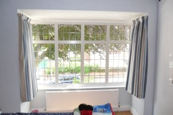 plastic curtain track for bay windows bay window curtain tracks that look great and work even better