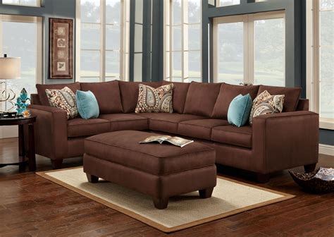 living room with brown sofa turquoise is a great accent color to chocolate brown