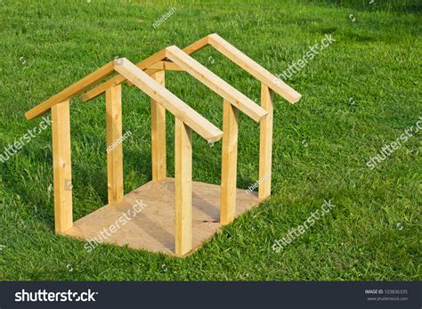 build a small dog house building small dog house lumber frame stock photo 103836335 shutterstock