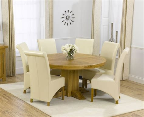 zenia oak 150cm round dining table amp 6 palermo leather chairs