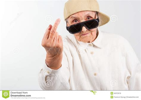 cool stock cool grandma showing her f finger stock photo image