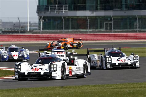 porsche with tree porsche team with three 919 hybrids for the