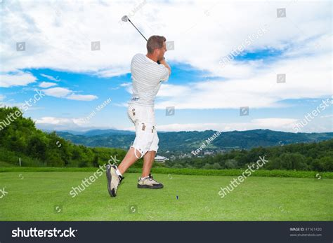 side view golf swing side view young golfer swing pose stock photo 47161420