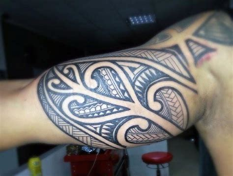tribal tattoos underarm 90 bicep tattoos for masculine design ideas
