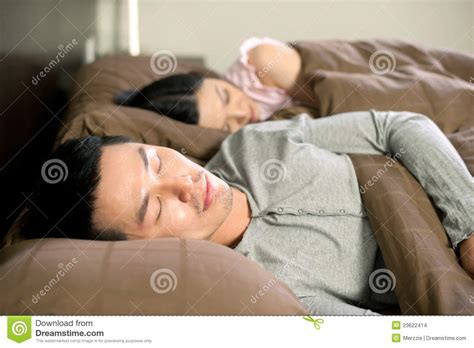 sleeping in asia asian couple lifestyle sleeping stock images image 23622414