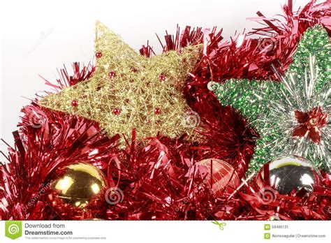 christmas tree stars and baubles of different types over a