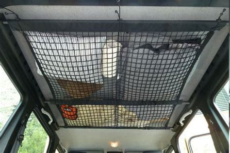 Bed For Small Space use a rv ceiling cargo net to add function to wasted space