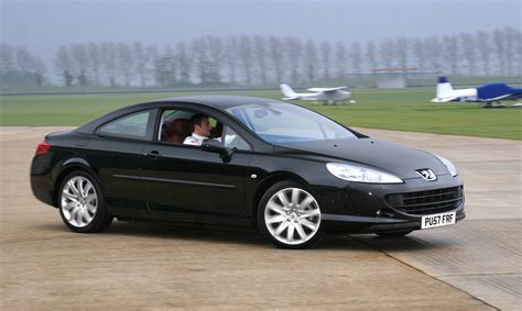 classic peugeot coupe 407 coupe handsome in an ugly kind of way we think