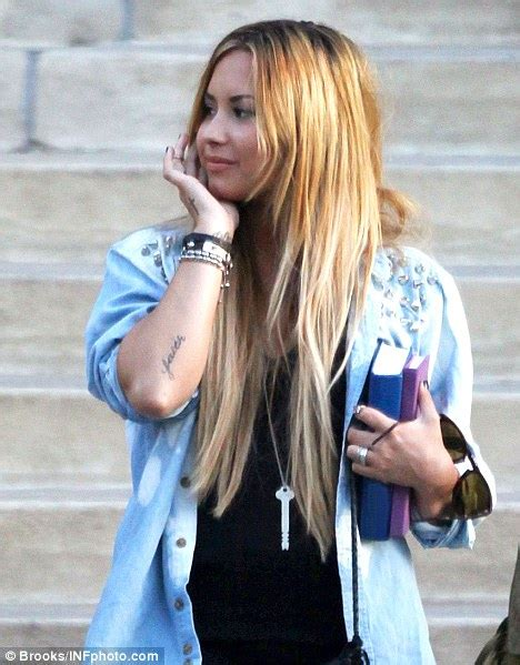 did demi lovato have blond hair demi lovato wears lucky charm on break from new x factor