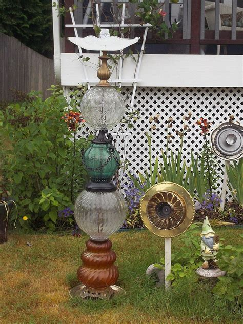 Hometalk   Recycled Glassware and Lamps Into Garden Totems