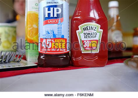 Shelf Of Tomato Sauce by Bottles Of Heinz Tomato Ketchup On A Shelf In A