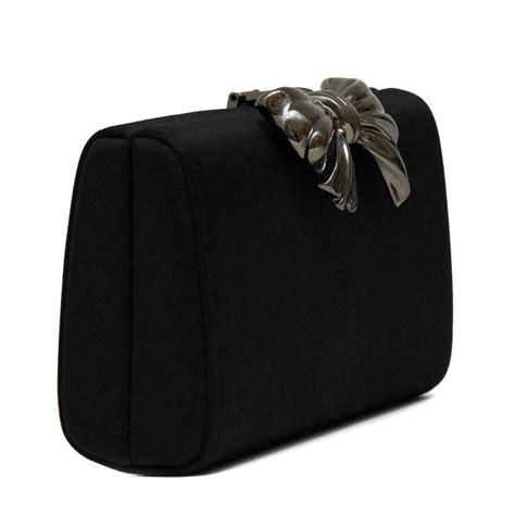 Rodo Satin Clutch 1980s rodo black satin clutch with metal bow detail for