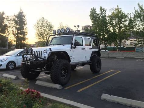 modded white jeep jeep wrangler unlimited modded rock krawler maximum