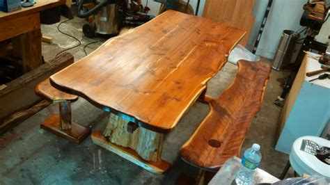 hand   edge cedar dining table  benches