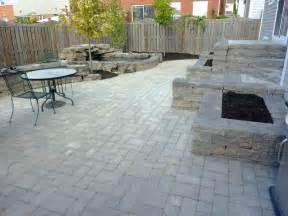 backyard patio and stone wall backyard water feature
