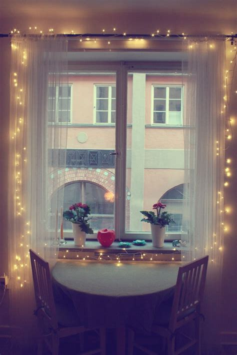 sheer white curtains with christmas lights love this idea