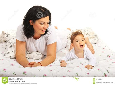 mom son bed happy mom with baby son in bed royalty free stock photo