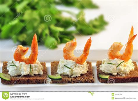 rye bread canapes canapes rye bread with ricotta cheese and tails of shrimps