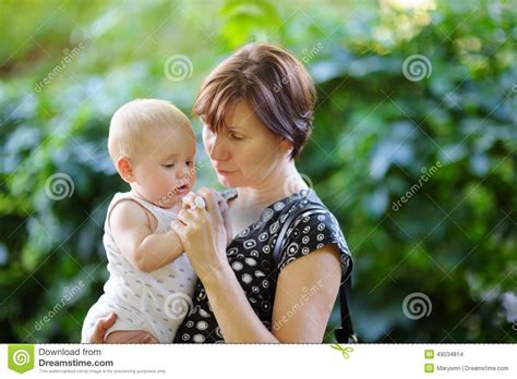 Middleage Woman Fun   beautiful middle aged woman and her adorable little