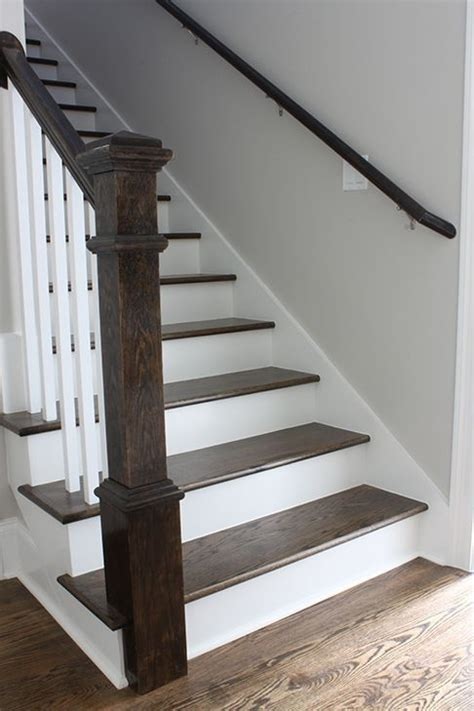 wood plank tile on staircase with white painted railings ideas a tour of our new house a blank slate and mixed metals