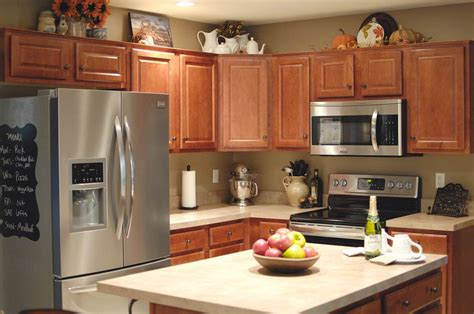 how to decorate above kitchen cabinets fall kitchen decor living rich on lessliving rich on less