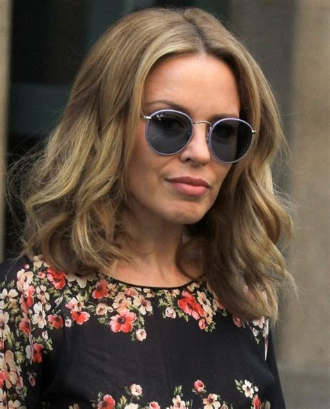 casual chignon updo hairstyle for women kylie minogue hairstyle 2014 kylie minogue hairstyles casual medium hair cut